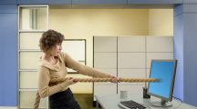 Mixed race businesswoman pulling rope from computer monitor - woman games