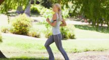 Side view of female jogger in the park - sport fitness